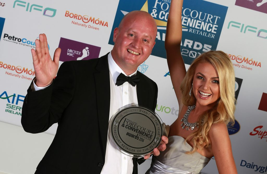 Maxol M3 Mulhuddart store manager Keith Doyle celebrates winning Forecourt Retailer of the Year with model Meagan Green