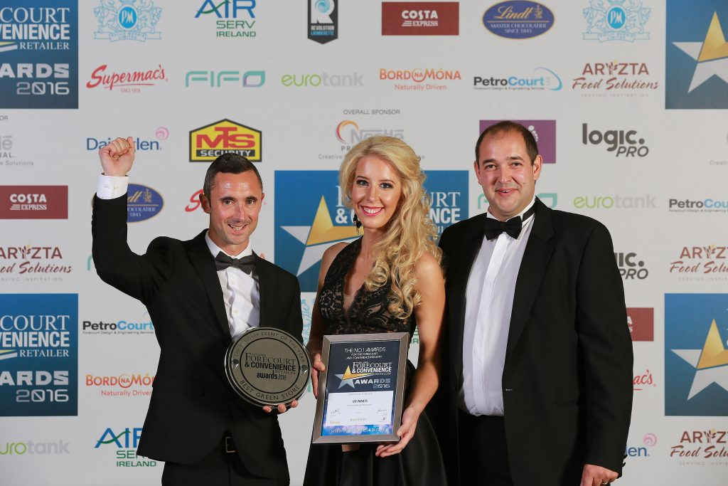 Karl Fitzgerald and Enesta Sukyte from Applegreen Mountgorry with John Jackson from category sponsor Eurotank with their Green Store of the Year trophy