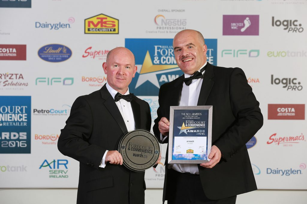 Accepting the award for Training Initiative of the Year is Applegreen's David McClean who is pictured with Gerry Scully from category sponsor MTS Security