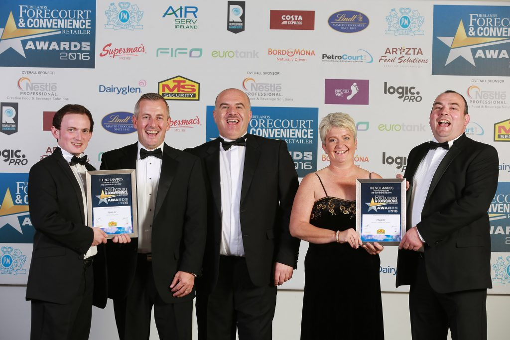 Pictured with their finalists' certificates are Alan Connolly and Keith Tomlinson, Centra, Portglenone; category sponsor, Gerry Scully, MTS Security; Ian Elliott and Lorraine Patterson, McCool's SuperValu, Ballymoney