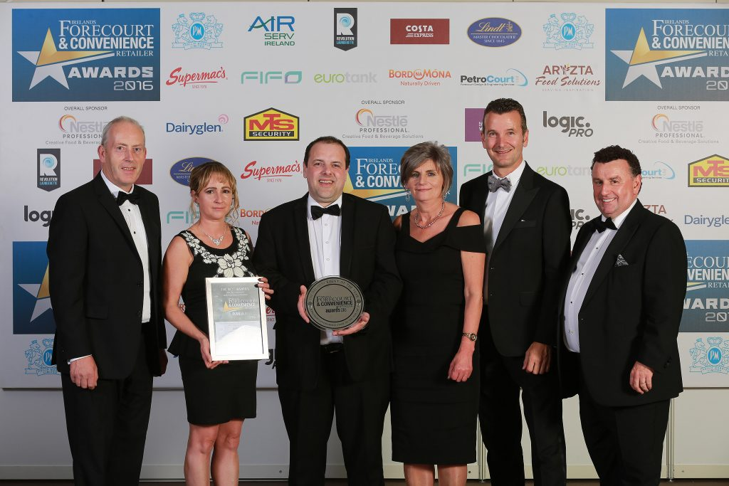 Accepting their award for the forecourt/Convenience Store of the Year with C-Store over 1,751 sq ft category, are the team behind Fitzpatrick's Spar Express: (L-R) owner Donal Fitzpatrick, Elaine Dempsey, store manager Patrick O'Hanlon, owner Teresa Fitzpatrick, and Walter Angst from category sponsor Lindt Ireland, and awards organiser Bill Penton. Donal and Teresa Fitzpatrick are also owners of the overall winner, Maxol M3 Mulhuddart in Dublin