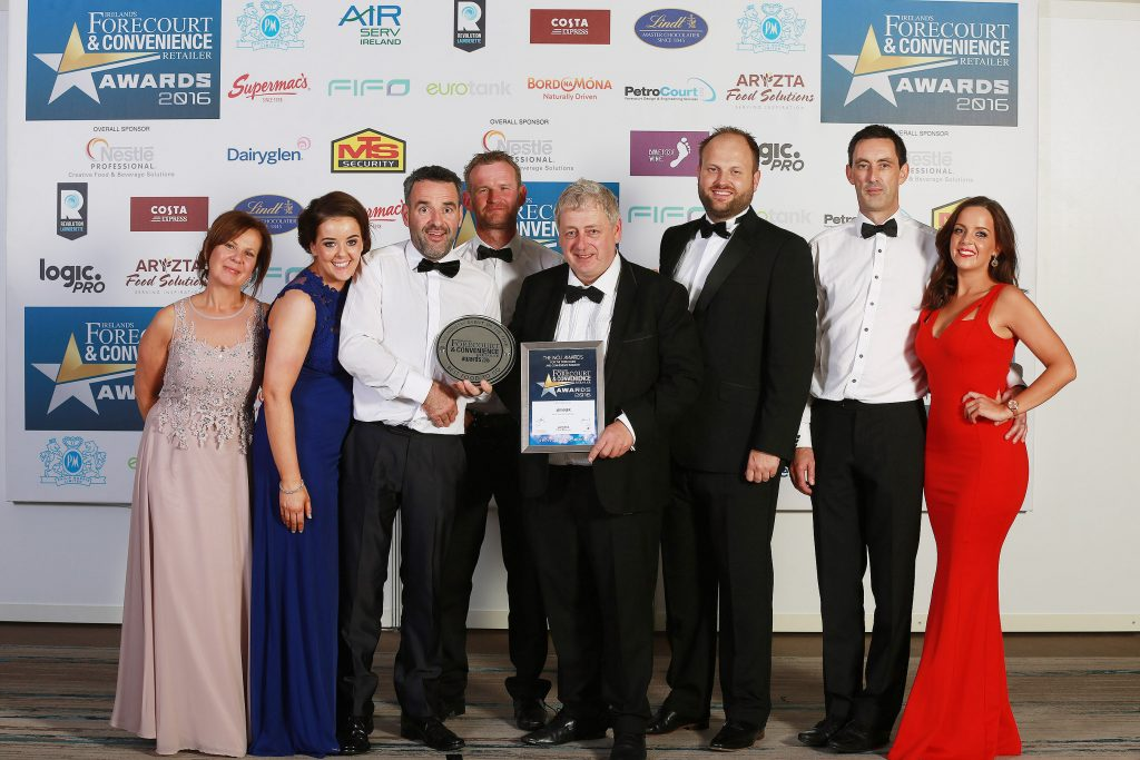Pictured (left to right) are the Milestone Nisa Rathfriland team: Christine McCann, Kirsty O'Hare, Mark Haughey, John McCarthy, Tom McAvoy (owner), Mark Hargadon (from category sponsor Aryzta), Raymond Finnegan, and Amy McAvoy