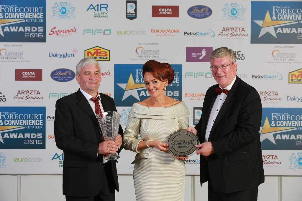 Owner of McCaughey's 24 hr Service Station in Broomfield Castleblayney, in Co Monaghan, Ray McCaughey, is pictured with his wife Margaret McCaughey, and Pat McDonagh, owner of category sponsor Supermac's