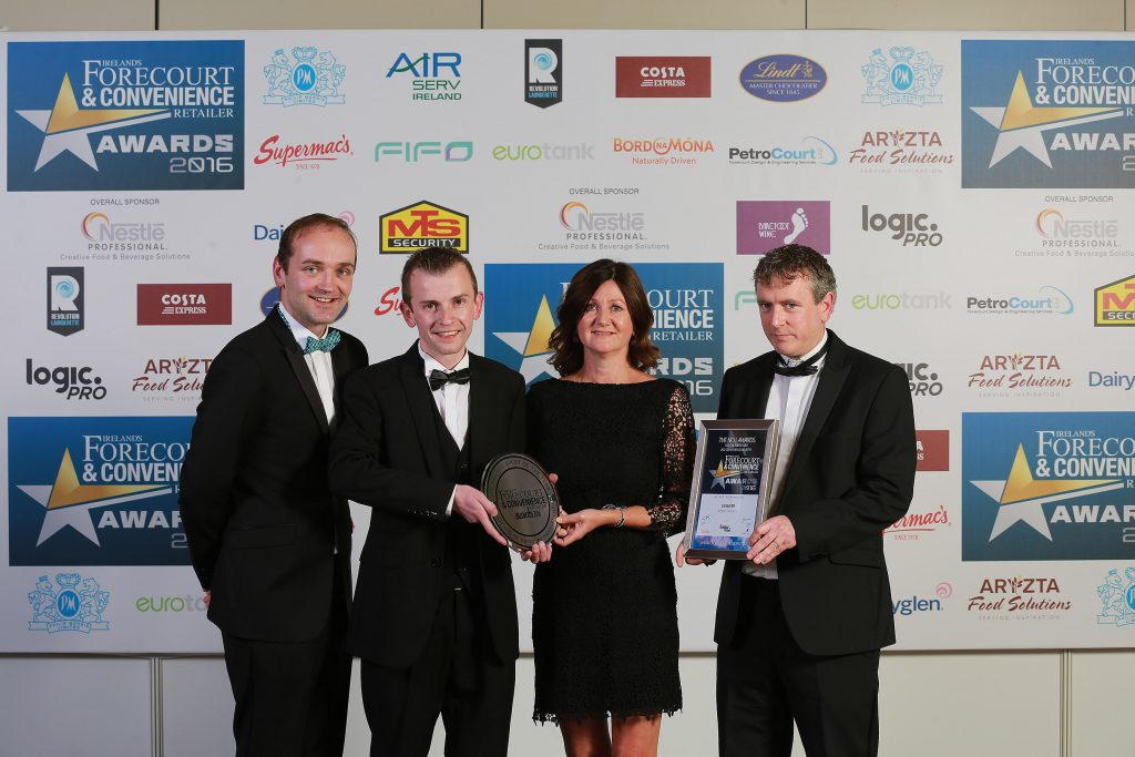 Accepting their award for Best Use of Category Management is Henry Healy, Paudie Byrne, Elaine Joyce (key account manager at category sponsor JTI Ireland), and Eoin O'Flaherty