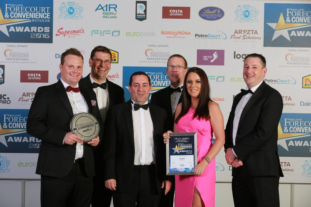 Accepting the award for Oil Company Initiative of the Year is the Topaz team of Alan Sheedy, Johnathan Diver, John Carr of category sponsor Costa, Declan Murphy, Judy Glover, and Enda O'Reilly
